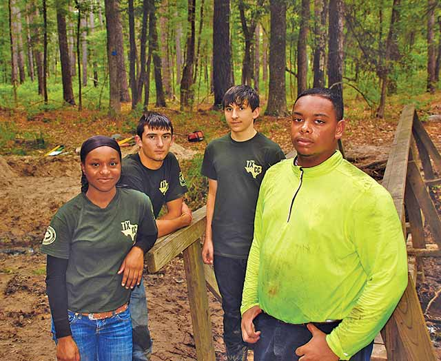 Kennard teens Colby Adair, Damien Stowe, Ethan Champagne and O'Keefe Peterson are spending part of their summer working in the Davy Crockett National Forest as part of the Youth Conservation Corps. (Photo Courtesy of USFS)