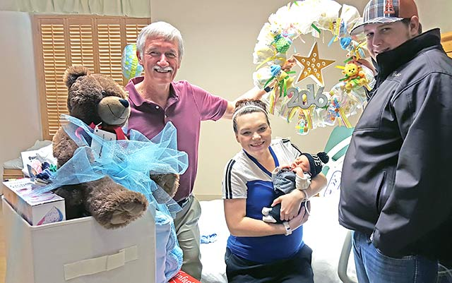 "Dr. Christopher Haeckler is shown presenting Morgan and Ryan Driskill of Centerville with ""Welcome to the World"" gifts in honor of their new son, Ryan Lee Driskill, Jr., born on Friday, Jan. 1, at Houston County Medical Center in Crockett. (Courtesy Photo)"