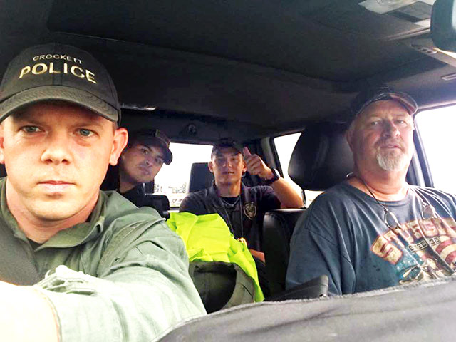 With the look of men filled with determination and on a mission, three Crockett police officers - Lt. Clayton Smith (front left), Sgt. Alfredo Fajardo (back left), Officer Blake Gates (back right) - and Crockett Precinct 5 Councilman Mike Marsh (front right) headed out in a monster truck pulling a flat bottom boat to rescue flood victims in southeast Texas. (Courtesy Photo/CPD)