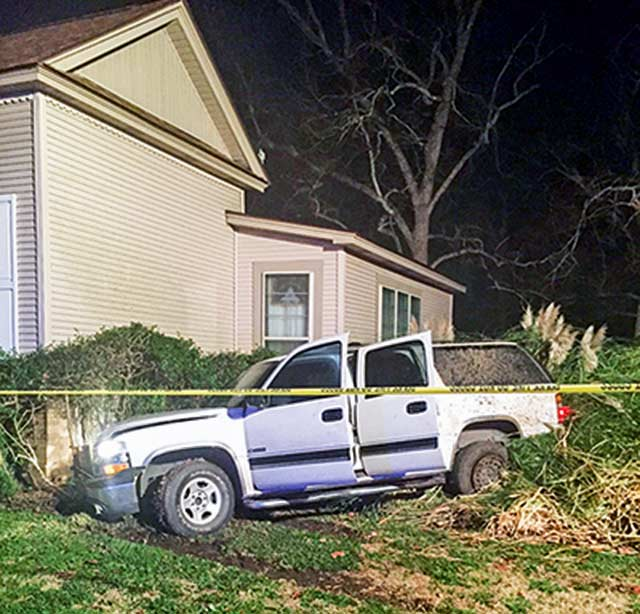 The pictured Suburban was stolen in Pasadena, then used by an aggravated robbery suspect in Crockett before the suspect lost control of the vehicle and crashed in Trinity County Monday, Dec. 21.  (CPD Photo)