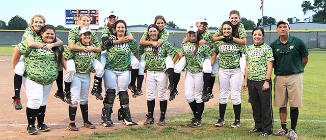 Latexo Lady Tigers pose for a victory photo after knocking off Alto 6-3 in bi-district Thursday night in Crockett.