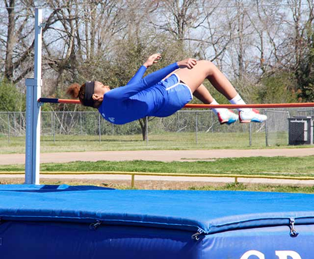 Lady Bulldog Octavia Davis clears the bar on the way to winning the high jump during the Bulldog Relays on Friday, March 6.
