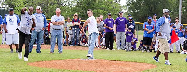 Kendall Rhodes, Will Pounds and Tyrone Colter (left to right), members of the 1996 Crockett Bulldogs State Championship Team, throw the ceremonial first pitches to launch the 2016 season of Crockett Merchants Little League on Saturday.