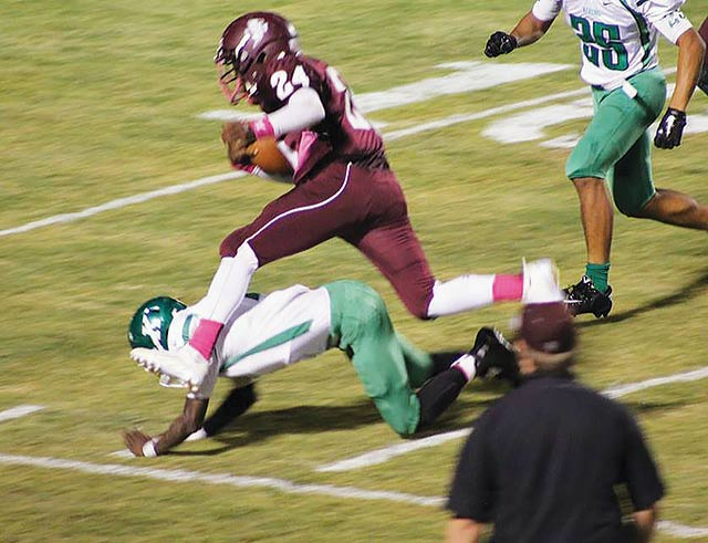 Grapeland's Jermorris Davis hurdles over a Kerens defender inside the 15 yard line. (Caleb Gayle Photo)
