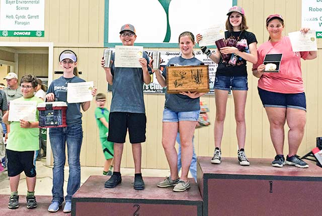 Brian Fiolek, Jamie Welch, Jack Crow, Sydnee Craven, Camryn Craven, Kara Fiolek, all members of the Houston County 4-H Shooting Sports Club, posed with their certificates and prizes won at the Brazos County Shoot last weekend, April 16-17. (Courtesy Photo)